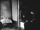 Interior scene showing tables with various personal objects, probably Washington, ca. 1910.