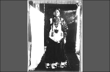 Copy of portrait of Lucy Irving, Makah woman, wearing Shoshone dress with bird designs and nose...