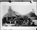 Hop kilns and crowd of people near Puyallup, Washington, ca. 1910