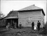 Homestead showing family in yard outside of house, Washington, ca. 1906.