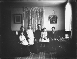 Family group with four children seated in sitting room, probably Washington, ca. 1905