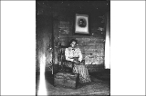 Unidentified woman seated in chair, Washington, ca. 1905