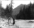 Four women viewing Eagle Peak from Nisqually River, Mount Rainier National Park, Washington, ca....