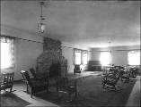 Sitting room with rustic furniture and stone fireplace probably of the National Park Inn Annex at...
