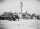 Military cadets or soldiers marching down road, location unknown, probably Washington State, ca....