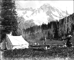 Family camping with tent at Indian Henry's Hunting Ground, Mount Rainier National Park,...