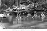Olympic Hot Springs resort pool in the woods showing several people bathing, Clallam County ;...