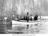 Flyer, a small steamboat, carrying passengers on Lake Crescent, Clallam County, ca. 1898