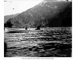 Woman with a child in a rowboat on Lake Crescent
