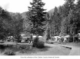 Rosemary Inn near Lake Crescent showing several cabins and two women sitting on the grass, Clallam...