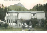 Marymere Hotel near Lake Crescent showing a group of people outside the entrance, Clallam County,...