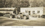 Lenoir's Cafe with a logging truck, cars and people outside the entrance, Fairholm, 1935