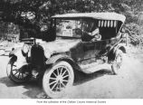 Passenger car and driver, Clallam County, 1920