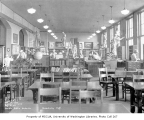 Broadway High School library interior showing painters at work, Capitol Hill neighborhood,...