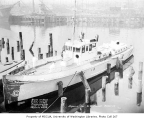 Navy ship moored in a harbor and awaiting repairs, possibly in Seattle, April 7, 1934