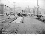 Street railroad workers laying concrete slabs at 21st Ave. and Jackson St., Central District of...