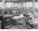 Sewing Center interior showing seamstresses at various tasks, Seattle, February 20, 1934