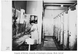 Seattle Public Library interior showing an employee cleaning the bathroom, Seattle, January 16,...