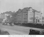 University Heights School exterior showing painters on scaffolding, University District, Seattle,...