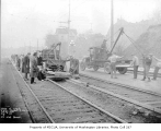 Street railroad workers laying concrete slabs at 2nd Ave. and Broad St., Denny Regrade...