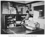 Seattle Public Library interior showing an employee organizing a supply room, Seattle, January 16,...