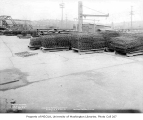 Concrete slab production yard showing steel girders on palettes, Ballard neighborhood, Seattle,...