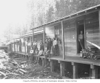 Logging crew outside of bunkhouses at camp, Bordeaux Lumber Company, ca. 1919