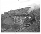 Crew with Weyerhaeuser Timber Company's Baldwin Mallet locomotive no. 6 on trestle with log train,...