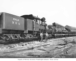 Crew with Willapa Harbor Lumber Company's three-truck Shay locomotive no. 904 at Camp Burt,...