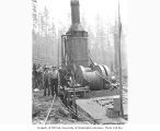 Logging crew with donkey engine used to lower logs down a 66 percent grade incline, with old...