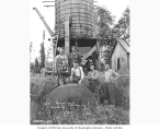 Crew and water tank at camp, Wynooche Timber Company, ca. 1921