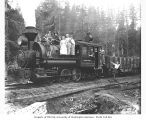 Men, women and dog with Wynooche Timber Company 0-6-4 side-tank locomotive no. 1, Montesano, ca....