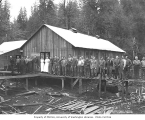 Logging and mess hall crews at camp on raised boardwalk outside mess hall, Wynooche Timber...