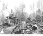 Crew with two donkey engines beside skidway, Wynooche Timber Company, ca. 1921