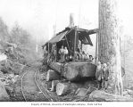 Loggers at loading site with donkey engine and railroad tracks, Mumby Lumber and Shingle Company,...