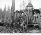 Loggers with donkey engine beside railroad track, Merrill & Ring Lumber Company, Pysht, ca....