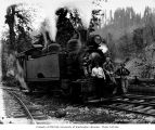 Loggers and locomotive, National Lumber and Manufacturing Company, probably in Grays Harbor...