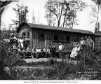 Loggers and camp crew at National Lumber and Manufacturing Company camp 7, probably in Cedarville,...