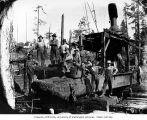 Loggers and donkey engine, National Lumber and Manufacturing Company, probably in Grays Harbor...