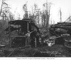Loggers with donkey engine and logs loaded on a skeleton car, National Lumber and Manufacturing...