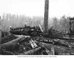 Loggers at loading site, National Lumber and Manufacturing Company, probably in Grays Harbor...