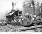Loggers with donkey engine on skids beside railroad tracks, Schafer Brothers Logging Company,...