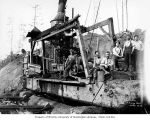 Loggers and donkey engine at loading site beside railroad skeleton car, Schafer Brothers Logging...
