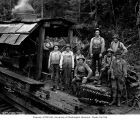 Rigging crew with donkey engine on railroad skeleton car, camp 1, Schafer Brothers Logging...