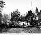 Loggers and mess hall crew at camp 4, with Schafer Brothers Logging Company's two-truck Heisler...