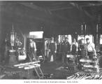Blacksmith shop interior and crew, Donovan-Corkery Logging Company, ca. 1928