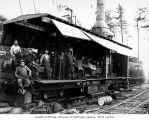 Crew with Willamette donkey engine on railroad skeleton car, Schafer Brothers Logging Company,...