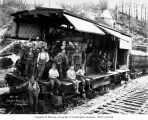 Crew with donkey engine on railroad flatcar, Schafer Brothers Logging Company, probably in Grays...