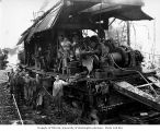Crew with donkey engine on flatbed railroad car, Schafer Brothers Logging Company, probably in...