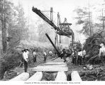 Asian railroad construction crew and track laying machine, Schafer Brothers Logging Company,...